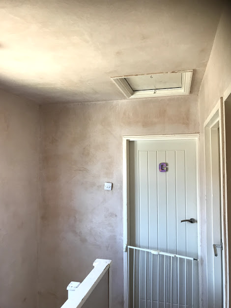 Stairwell after walls and ceilings have been repaired and skimmed using Thistle Pro DuraFinish Plaster
